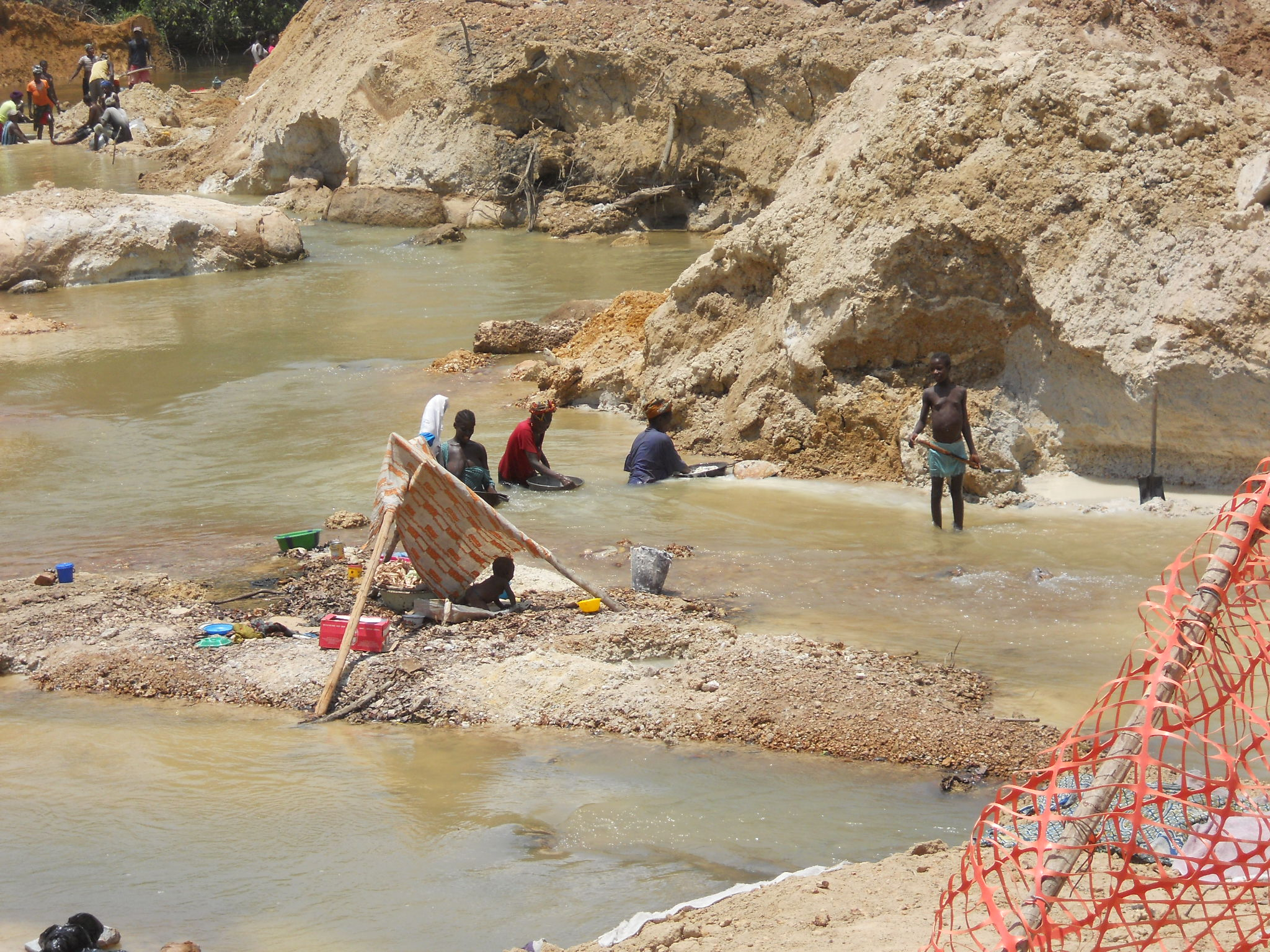 Locals gold mining on mine construction site