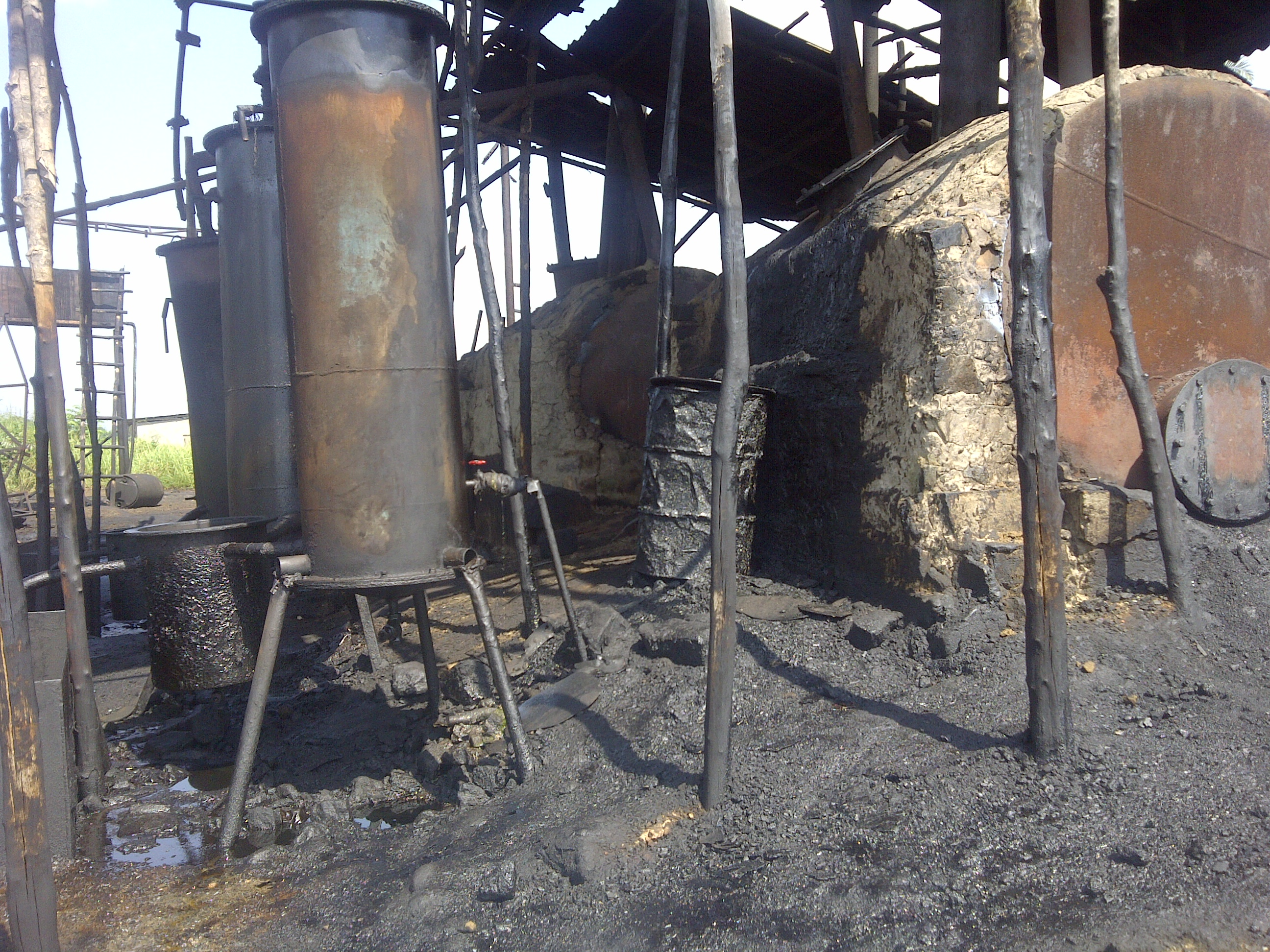Primitive technology waste oil processing causing pollution